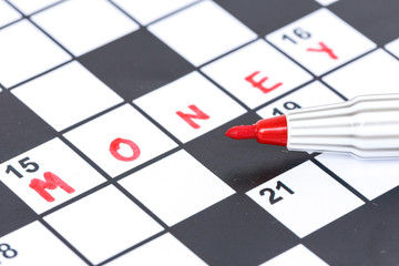 Close up red marker on Crossword - Money