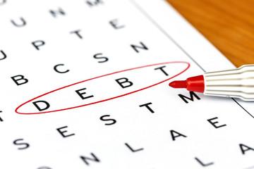Debt in solving crossword puzzle, close up