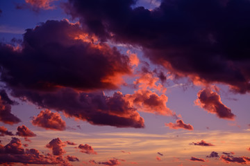 Fotobehang - dark clouds in the red sky at sunset