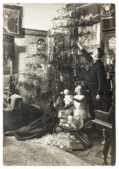parents and child with christmas tree