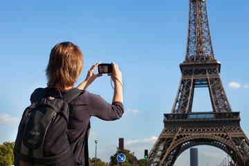 tourist in Paris, woman taking photo of Eiffel Tower