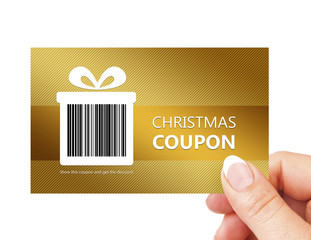 hand holding christmas coupon isolated over white