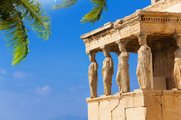 Beautiful view of Erechtheion with palm in Athens