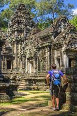 Young man admires amazing Angkor Wat Temple, Cambodia