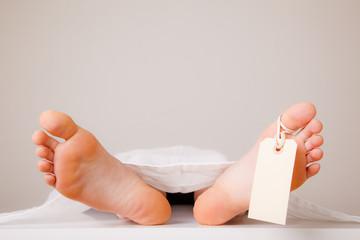 Two feet of a dead body