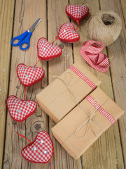 parcels wrapped in brown paper and string with ribbon and scisso