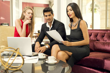 Business meeting with two businesswomen and a businessman