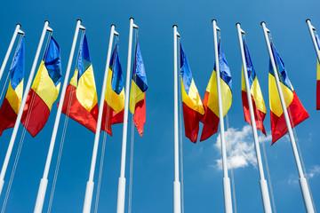 Romanian Flag Poles On Blue Sky