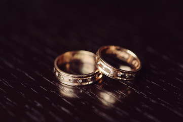 Golden Rings on Dark Table