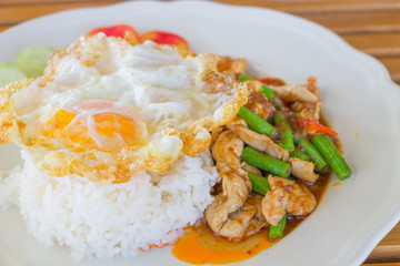 Chicken and cowpea fried with chillies ,fried egg