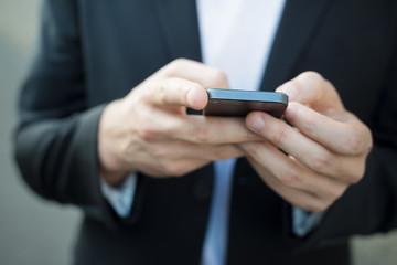 close up hands man using smart phone