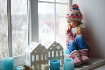 Little girl on a window sill