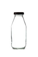 Empty glass bottle of milk with cap