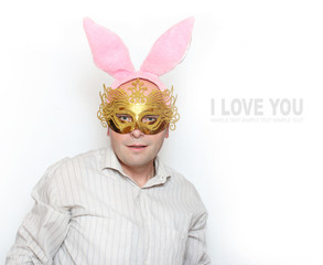 Man in love with paper mask and rabbit ears. Valentine greeting.