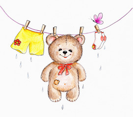 Teddy bear hanging on a rope