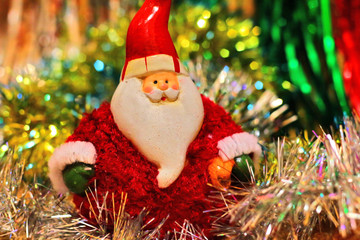 Festive colored background with Christmas tinsel and Santa Claus