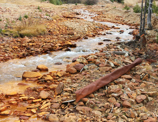 Polluted stream and rusted metal in Colorado