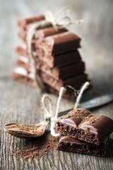 Fototapete - Tasty porous chocolate on wooden table