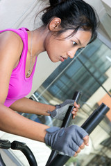 woman exercises in a gym