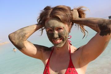 Beautiful girl with mud mask