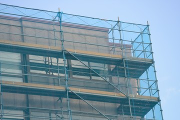 protective mesh covering the scaffolding on the building