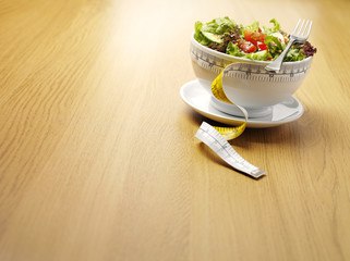 Dieting with a Bowl of Salad and Tape Measure