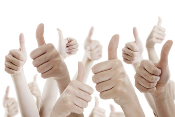 Many people holding their thumbs up