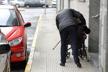disabled in a wheelchair on a city street