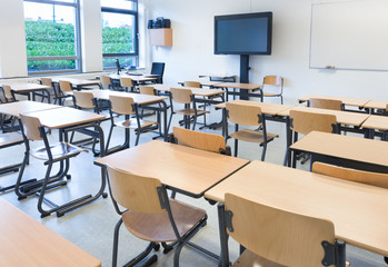 Empty classroom with tables and chairs