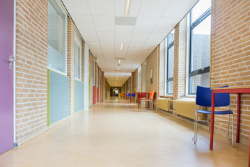 Long corridor with furniture in school building