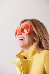 happy blonde woman wearing weird sunglasses