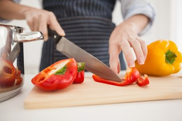 Woman slicing up red pepper
