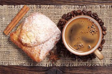 Coffee cup and fresh bun