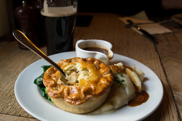 Traditional chicken pot pie in authentic UK pub setting