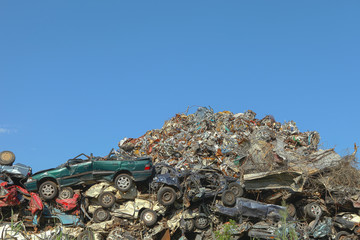 Scrap yard with cars and metal