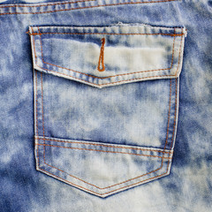 eans pocket. Denim background.