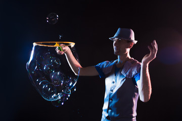 Man with  big soap  bubbles