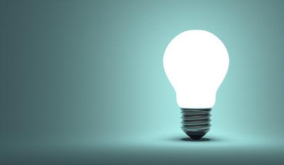 Shining arbitrary light bulb on blue