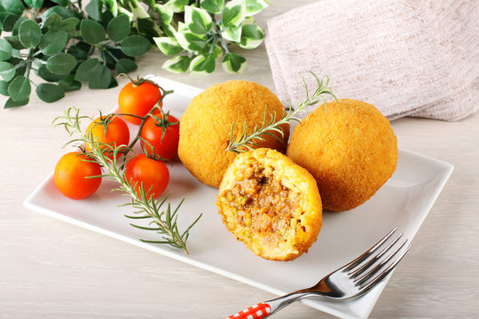 Arancini, rice balls with meat and sauce