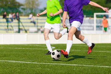football soccer game. footballers in action. running players