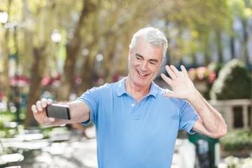 Senior Man Taking a Selfie at Park