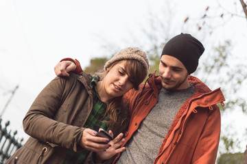 Young couple with the smartphone