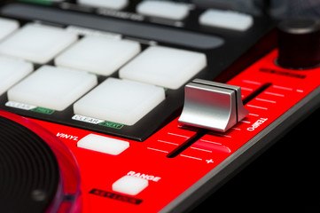 DJ mixer controller. Fader and buttons of red mixing console.