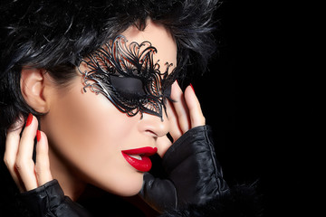 Masquerade. High Fashion Portrait of Beautiful Woman with Black