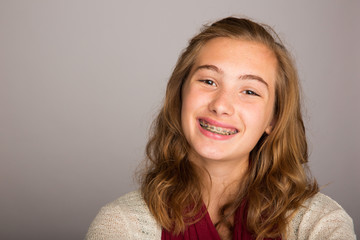 happy teenage girl wearing braces