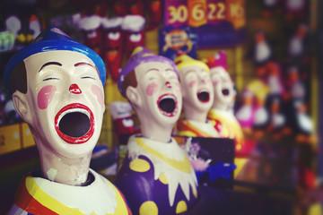 Laughing clowns at the fair ground