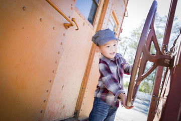 Cute Young Mixed Race Boy Having Fun on Railroad Car