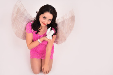 Christmas sexy girl angel praying, with a gift