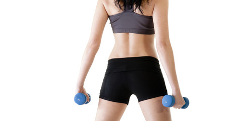 Close up of young woman exercising with dumbbells