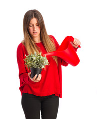 young cool girl with a plant and a water can